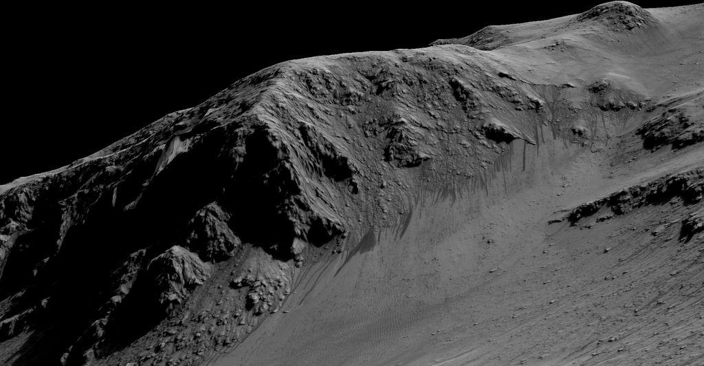 Aliran arus yang mengalir kebawah atau Recurring Slope Lineae pada lereng kawah Horowitz. Kredit : NASA/JPL-Caltech/Univ. of Arizona